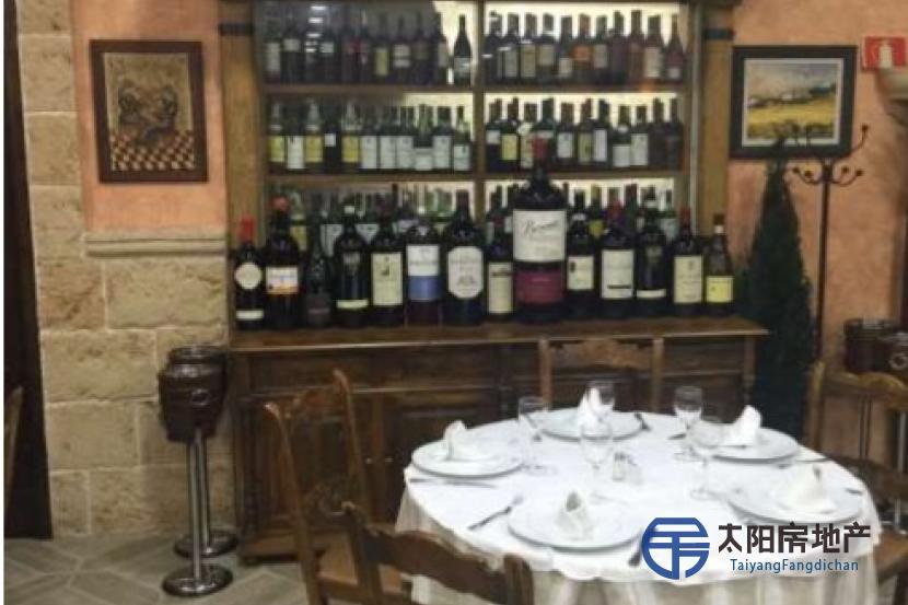 Restaurante asador con premio a la mejor paella valenciana del mundo